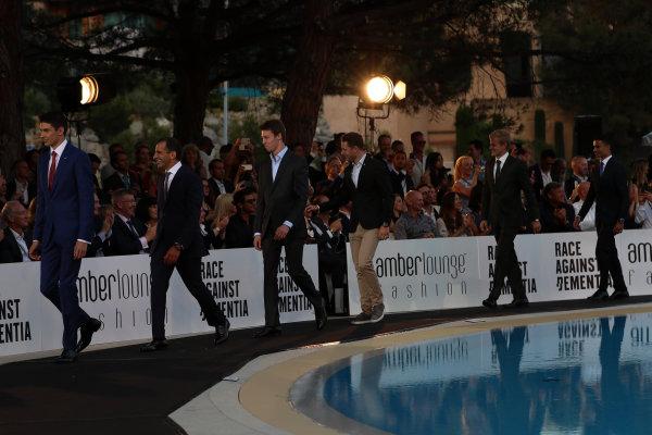 Monte Carlo, Monaco. Friday 26 May 2017. Esteban Ocon (FRA) Force India F1, Marc Gene (ESP) Ferrari, Daniil Kvyat (RUS) Scuderia Toro Rosso, Stoffel Vandoorne (BEL) McLaren, Marcus Ericsson (SWE) Sauber and Pascal Wehrlein (GER) Sauber at the Amber Lounge Fashion Show, Le Meridien Beach Plaza Hotel, Monaco World Copyright: Mark Sutton/Sutton/LAT Images ref: Digital Image dcd1726my214