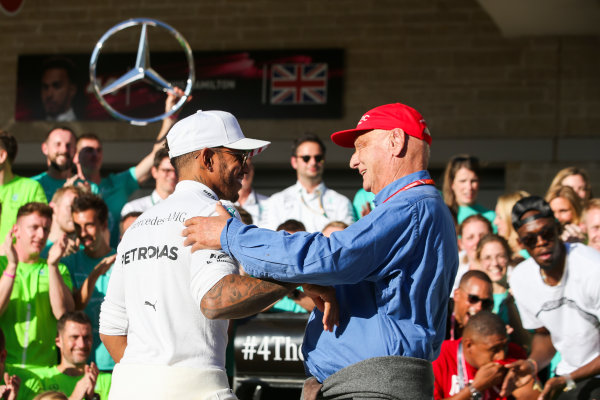 Circuit of the Americas, Austin, Texas, United States of America. Sunday 22 October 2017. Lewis Hamilton, Mercedes AMG, 1st Position, celebrates winning the race and the Constructors title with Niki Lauda, Non-Executive Chairman, Mercedes AMG, and his team. World Copyright: Charles Coates/LAT Images  ref: Digital Image AN7T2344