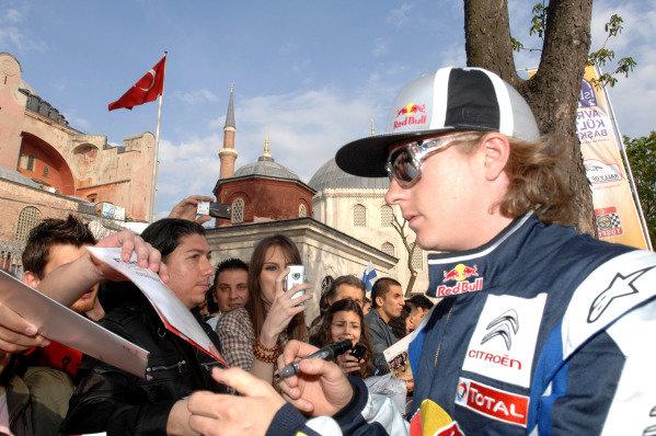 Kimi Raikkonen (FIN) signing autographs before the ceremonial start. FIA World Rally Championship, Rd 4, Rally Turkey, Shakedown, Pendik, Istanbul, Turkey, 15 April 2010.
