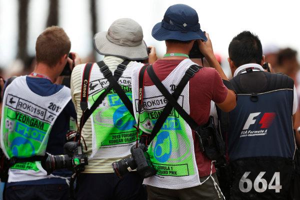 Korea International Circuit, Yeongam-Gun, South Korea. Sunday 6th October 2013. Photographers at the drivers parade. World Copyright: Charles Coates/LAT Photographic. ref: Digital Image _N7T5695