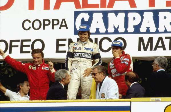 Monza, Italy.9-11 September 1983.Nelson Piquet (Brabham BMW) 1st position, Rene Arnoux (Ferrari) 2nd position and Eddie Cheever (Equipe Renault) 3rd position on the podium. FIA President Jean-Marie Balestre stands at the front.Ref-83 ITA 09.World Copyright - LAT Photographic