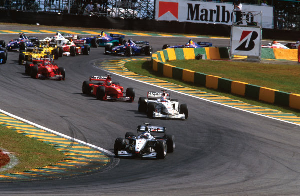 Interlagos, Sao Paulo, Brazil. 9th - 11th April 1999. Mika Hakkinen (McLaren MP4/14-Mercedes), 1st position, leads at the start, action.  World Copyright: LAT Photographic. Ref:  99 BRA 08.