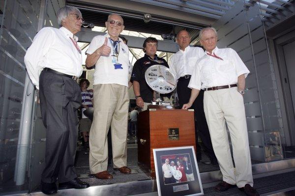 2006 British Grand Prix - Saturday Qualifying Silverstone, England. 8th - 11th June. The Tom Wheatcroft Trophy is presented to Professor Juergen Hubbard, Daimler Chrysler, by Bernie Ecclestone, atmosphere. World Copyright: Lorenzo Bellanca/LAT Photographic ref: Digital Image MU4Z0370