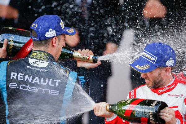 2016/2017 FIA Formula E Championship. Monte-Carlo, Monaco Saturday 13 May 2017. Sebastien Buemi (SUI), Renault e.Dams, Spark-Renault, Renault Z.E 16, sprays the champagne on the podium with Nick Heidfeld (GER), Mahindra Racing, Spark-Mahindra, Mahindra M3ELECTRO. Photo: Alastair Staley/LAT/Formula E ref: Digital Image _X0W1395
