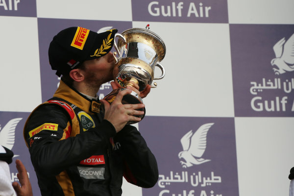 Bahrain International Circuit, Sakhir, Bahrain Sunday 21st April 2013 Romain Grosjean, Lotus F1, 3rd position, kisses his trophy. World Copyright: Andy Hone/LAT Photographic ref: Digital Image HONZ3068