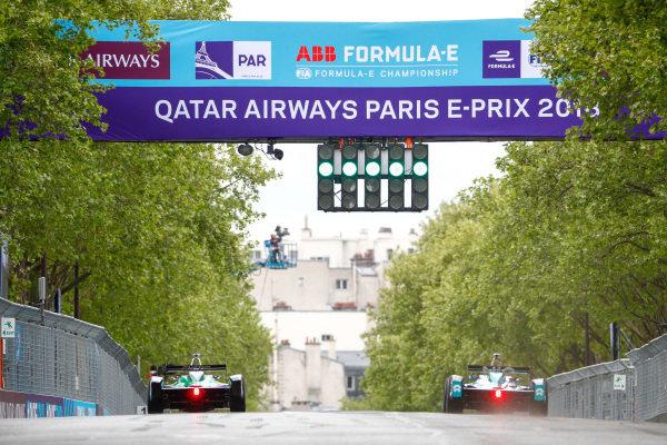 Lucas Di Grassi (BRA), Audi Sport ABT Schaeffler, Audi e-tron FE04, side by side with Ma Qing Hua (CHI), NIO Formula E Team, NextEV NIO Sport 003.