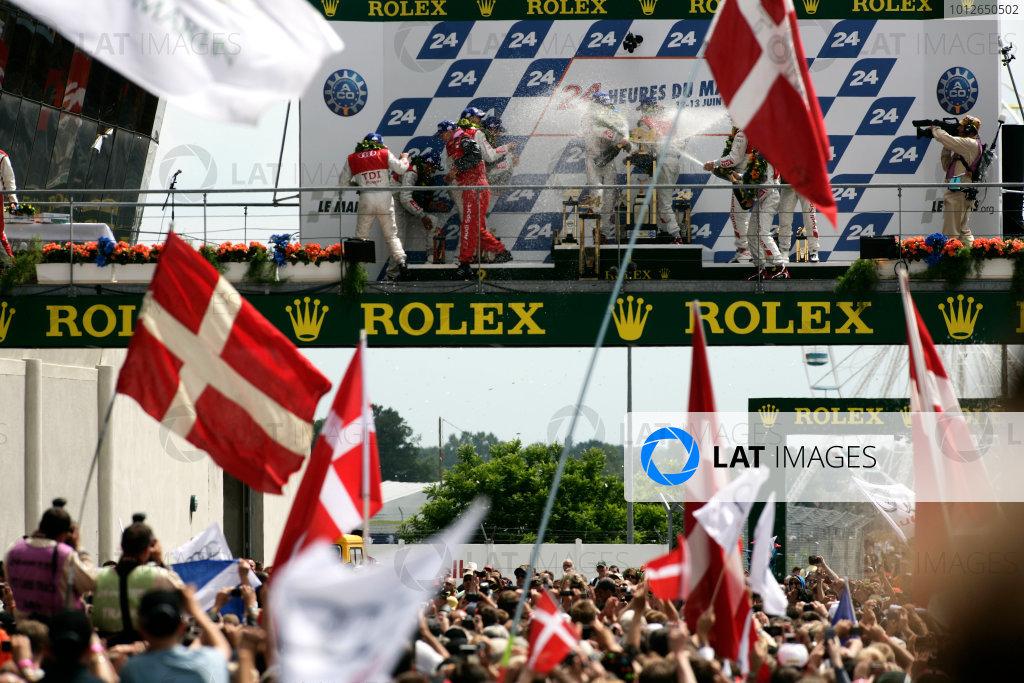 Circuit de La Sarthe, Le Mans, France. 6th - 13th June 2010.Mike Rockenfeller / Timo Bernhard / Romain Dumas, Audi Sport North America, No 9 Audi R15-Plus TDI celebrate victory on the podium with Andre Lotterer / Marcel Fassler / Benoit Treluyer, Audi Sport Team Joest, No 8 Audi R15-Plus TDI and Tom Kristensen / Dindo Capello / Allan McNish, Audi Sport Team Joest, No 7 Audi R15-Plus TDI. Portrait. Atmosphere. World Copyright: Drew Gibson/LAT PhotographicDigital Image _Y8P6648