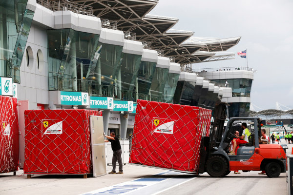 Sepang International Circuit, Sepang, Kuala Lumpur, Malaysia. Sunday 29 March 2015. The Ferrari team pack their equipment after a successful race weekend. World Copyright: Alastair Staley/LAT Photographic. ref: Digital Image _R6T6511