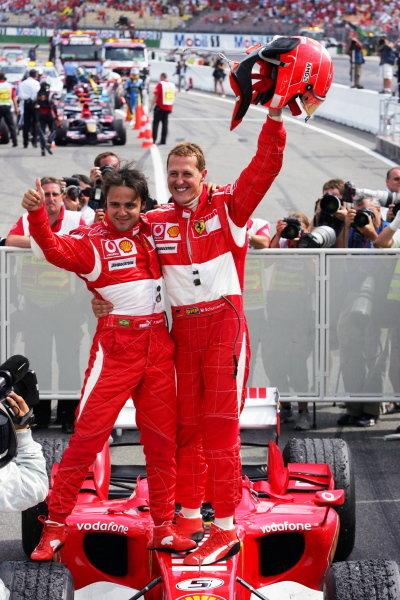 Race winner Michael Schumacher (GER) Ferrari (Right) and second placed team mate celebrate in parc ferme. Formula One World Championship, Rd 12, German Grand Prix, Race, Hockenheim, Germany, 30 July 2006. DIGITAL IMAGE  BEST IMAGE