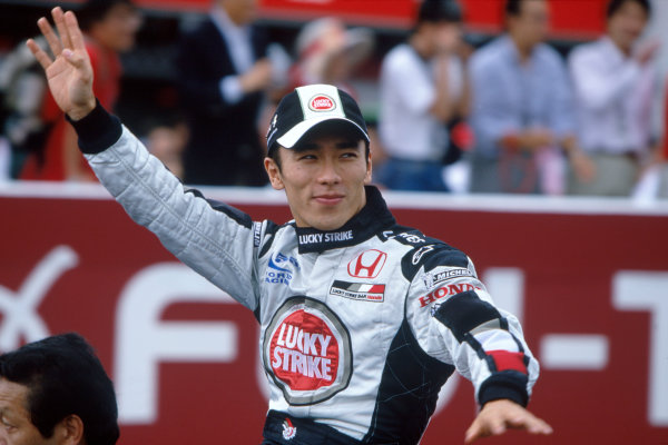 2004 Japanese Grand Prix.Suzuka , Japan 8th - 10th October 2004Takuma Sato, BAR Honda 006 waves to his fans as he is driven around the track.World Copyright:Steven Tee/LAT Photographic ref: 35mm Image: A05