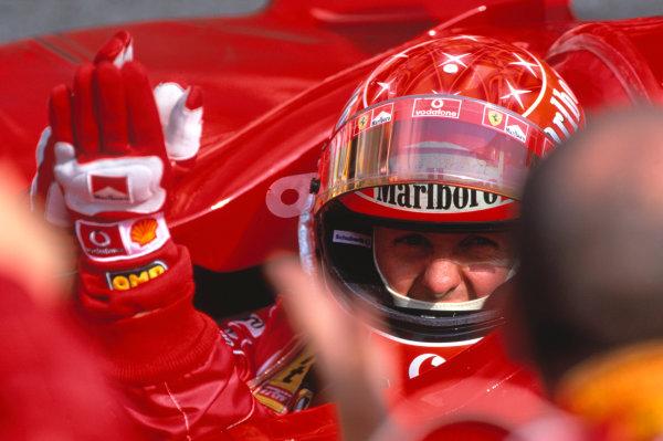2004 German Grand PrixHockenheim, Germany. 23rd - 25th July.Michael Schumacher, Ferrari F2004 celebrates his win in parc ferme.World Copyright:Peter Spinney/LAT Photographic Ref:35mm Image:A20