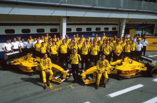 The DHL Jordan Honda team including (Front L-R) Giancarlo Fisichella (ITA), Team Boss Eddie Jordan (IRE) and Takuma Sato (JPN) and two Jordan Honda EJ12 cars.Formula One World Championship, Rd6, Austrian Grand Prix, A1-Ring, Austria. 12 May 2002.BEST IMAGE