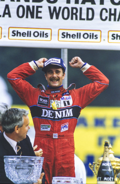 Nigel Mansell, 1st position, celebrates on the podium.