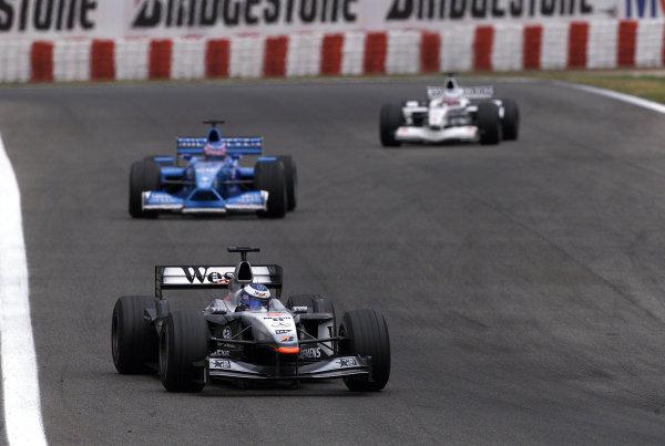 2001 Spanish Grand PrixCatalunya, Barcelona, Spain. 27-29 April 2001.Mika Hakkinen (McLaren MP4/16 Mercedes) followed by Jenson Button (Benetton B201 Renault) and Olivier Panis (B.A R. 003 Honda).World Copyright - Steve Etherington/LAT Photographicref: 18 mb Digital Image
