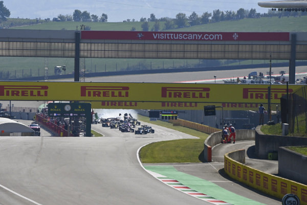 Lewis Hamilton, Mercedes F1 W11 EQ Performance, leads the field as a crash develops at the restart