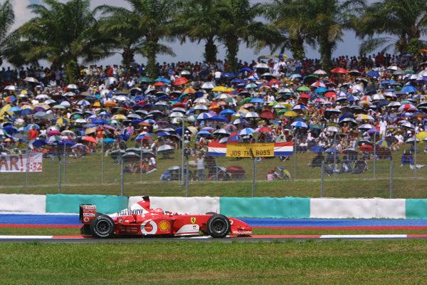 2003 Malaysian Grand Prix. Sepang, Kuala Lumpur, Malaysia.21-23 March 2003.Michael Schumacher (Ferrari F2002) 6th position.World Copyright - LAT Photographic ref: Digital Image Only