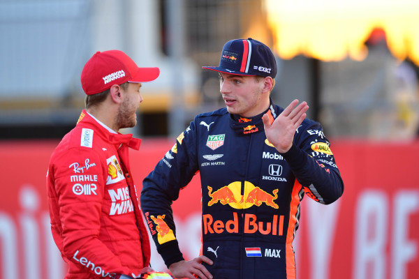 Sebastian Vettel, Ferrari, with Max Verstappen, Red Bull Racing, after qualifying