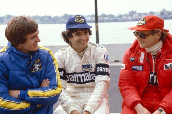 1982 United States Grand Prix East.Detroit, Michigan, USA.4-6 June 1982.Eddie Cheever (Ligier Matra), Nelson Piquet (Brabham BMW) and Niki Lauda (McLaren Ford) have a chat.Ref-82 USA 05.World Copyright - LAT Photographic