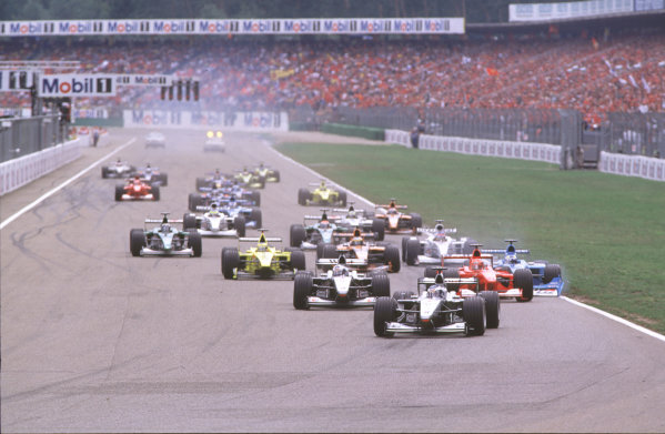 2000 German Grand Prix.Hockenheim, Germany.28-30 July 2000.Mika Hakkinen leads David Coulthard (both McLaren MP4/15 Mercedes) as Michael Schumacher (Ferrari F1-2000) pulls across into Giancarlo Fisichella (Benetton B200 Playlife) on the approach to the Nordkurve at the start, resulting in a crash.World Copyright - Coates/LAT Photographiccrash sequence 01.ref: 35mm A01