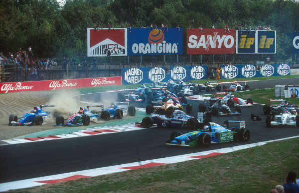 1994 Italian Grand Prix.Monza, Italy.9-11 September 1994.Johnny Herbert (Lotus 109 Mugen-Honda) is spun round at the Rettifilo Chicane at the start by Eddie Irvine (Jordan 194 Hart) because he could not brake as quickly as him so ended up hitting him from behind. David Coulthard (Williams FW16B Renault) is caught by Herbert and spins whilst everybody else takes avoiding action in the melee.Ref-94 ITA 08.World Copyright - LAT Photographic