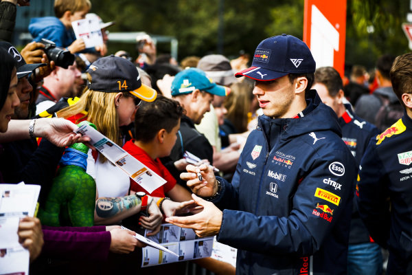 Pierre Gasly, Red Bull Racing signs a autograph for a fan at the Federation Square event
