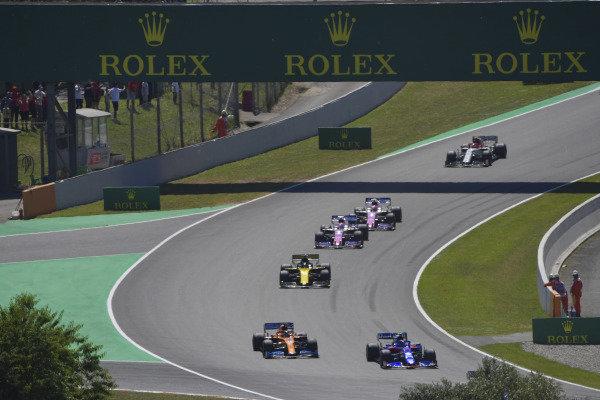 Alexander Albon, Toro Rosso STR14, leads Carlos Sainz Jr., McLaren MCL34, Daniel Ricciardo, Renault R.S.19, Sergio Perez, Racing Point RP19, and Lance Stroll, Racing Point RP19
