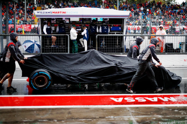 Autodromo Nazionale di Monza, Italy. Saturday 02 September 2017. Haas team members push the car of Romain Grosjean, Haas VF-17, back into the pits as Sir Jackie Stewart, 3-time F1 Champion, and Felipe Massa, Williams Martini Racing, watch from the Williams Racing pit wall. World Copyright: Glenn Dunbar/LAT Images  ref: Digital Image _X4I9737
