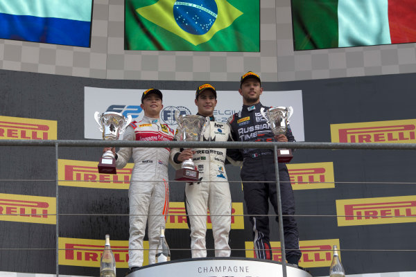 2017 FIA Formula 2 Round 8. Spa-Francorchamps, Spa, Belgium. Sunday 27 August 2017. Sergio Sette Camara (BRA, MP Motorsport) celebrates his victory on the podium with Nyck De Vries (NED, Racing Engineering) and Luca Ghiotto (ITA, RUSSIAN TIME).  Photo: Alastair Staley/FIA Formula 2. ref: Digital Image _L5R6107