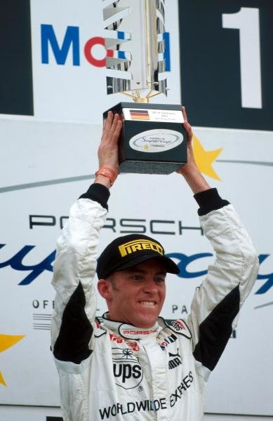 Race winner Timo Bernhard (GER) celebrates victory.