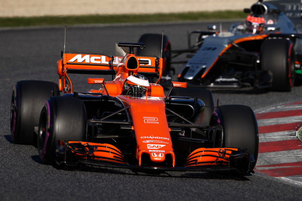 Circuit de Barcelona Catalunya, Barcelona, Spain. Tuesday 07 March 2017. Stoffel Vandoorne, McLaren MCL32 Honda, leads Esteban Ocon, Force India VJM10 Mercedes. World Copyright: Glenn Dunbar/LAT Images ref: Digital Image _31I5254