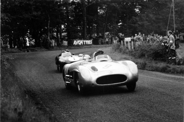 1955 Tourist Trophy. Dundrod, Great Britain. 17 September 1955. Juan Manuel Fangio/Karl Kling (Mercedes-Benz 300SLR), 2nd position, leads Mike Hawthorn/Desmond Titterington (Jaguar D-type), action. Ref-331/29 World Copyright - LAT Photographic