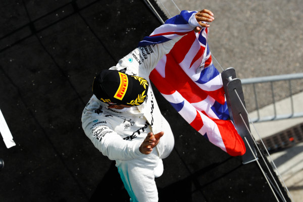 Circuit Gilles Villeneuve, Montreal, Canada. Sunday 11 June 2017. Lewis Hamilton, Mercedes AMG, celebrates victory on the podium with a British flag. World Copyright: Steven Tee/LAT Images ref: Digital Image _O3I0095