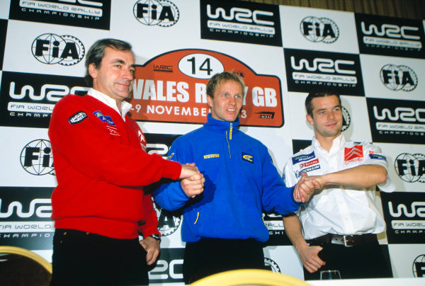 2003 World Rally ChampionshipRally of Great Britain, Wales. 6th - 9th November 2003.Carlos Sainz, Petter Solberg and Sebastien Loeb shake hands before the rally.World Copyright: Spinney/LATref: 35mm Image WRC_GB_18 jpg