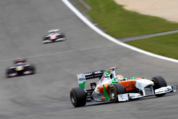 Nurburgring, Germany.24th July 2011Adrian Sutil, Force India VJM04 Mercedes, 6th position, leads Sebastien Buemi, Toro Rosso STR6 Ferrari, 15th position. Action. World Copyright: Andy Hone/LAT Photographicref: Digital Image CSP13243