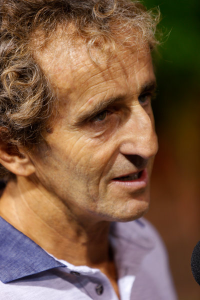 Marina Bay Circuit, Singapore. Friday 20th September 2013. F1 World Champion Alain Prost in the paddock. World Copyright: Charles Coates/LAT Photographic. ref: Digital Image _N7T2913