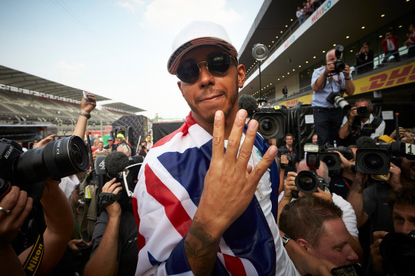 Autodromo Hermanos Rodriguez, Mexico City, Mexico. Sunday 29 October 2017. Lewis Hamilton, Mercedes AMG, holds up four fingers to the camera in recognition of securing his 4th world drivers championship title. World Copyright: Steve Etherington/LAT Images  ref: Digital Image SNE14478