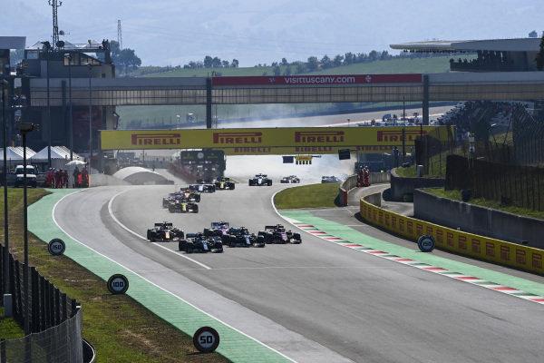 Lewis Hamilton, Mercedes F1 W11 EQ Performance, leads Valtteri Bottas, Mercedes F1 W11 EQ Performance, Charles Leclerc, Ferrari SF1000, Alexander Albon, Red Bull Racing RB16, and the rest of the field as a crash develops behind