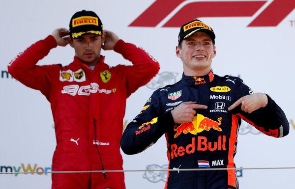 Race winner Max Verstappen, Red Bull Racing celebrates on the podium with Charles Leclerc, Ferrari