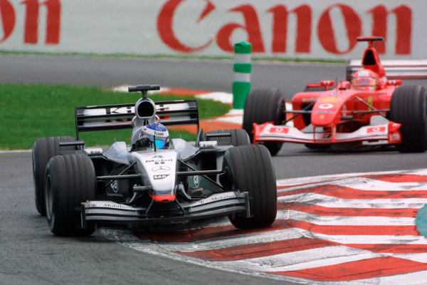 2002 French Grand Prix - RaceMagny-Cours, France. 21st July 2002Kimi Raikkonen (McLaren MP4/17-Mercedes) leads Michael Schumacher (Ferrari F2002).World Copyright - LAT Photographicref: digital file