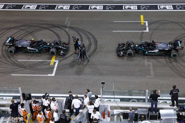 Lewis Hamilton, Mercedes-AMG Petronas F1, 3rd position, and Valtteri Bottas, Mercedes-AMG Petronas F1, 2nd position, congratulate each other on the grid after performing donuts