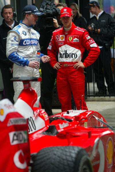 2002 Qantas Australian Grand Prix - race.Albert Park, Melbourne, Australia. 3rd March 2002.Ralf and Michael Schumacher.World Copyright: Steve Etherington/LAT Photographic ref: Digital Image Only