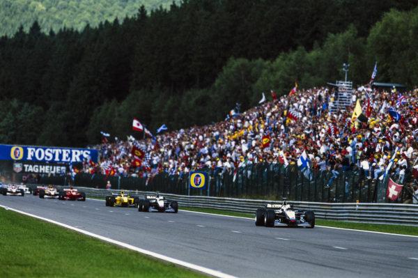 David Coulthard, McLaren MP4-14 Mercedes, leads Mika Häkkinen, McLaren MP4-14 Mercedes, and Heinz-Harald Frentzen, Jordan 199 Mugen-Honda.