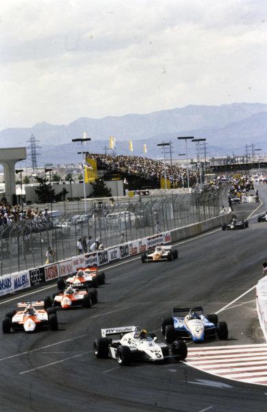 Derek Daly, Williams FW08 Ford, leads Jacques Laffite, Ligier JS19 Matra, John Watson, McLaren MP4-1B Ford, Andrea de Cesaris, Alfa Romeo 182, and Niki Lauda, McLaren MP4-1B Ford.