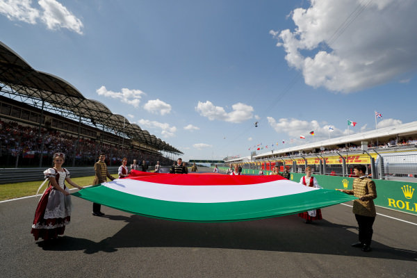 A large Hungarian flag is unfurled as part of the pre race grid celebrations