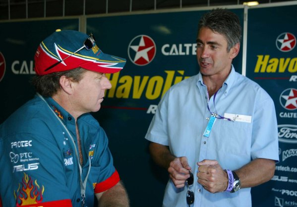 2002 Australian V8 SupercarsAdelaide Clipsal 500. Australia. 17th March 2002.Former 500cc World Champion Wayn Gardner now driving for the Caltex Ford team talks with 5 times World 500cc Champion Mick Doohan.World Copyright: Mark Horsburgh/LAT Photographicref: Digital Image Only