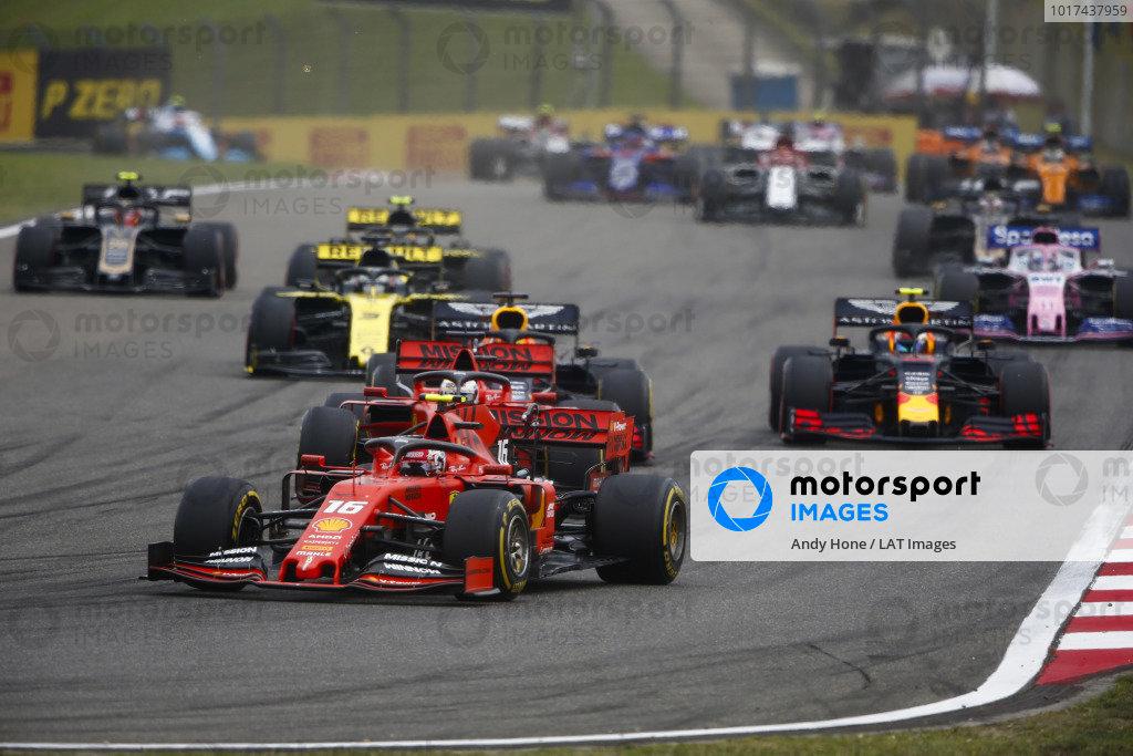 Charles Leclerc, Ferrari SF90, leads Sebastian Vettel, Ferrari SF90, Max Verstappen, Red Bull Racing RB15, Pierre Gasly, Red Bull Racing RB15, and Daniel Ricciardo, Renault R.S.19