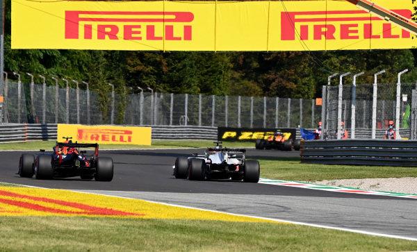 Carlos Sainz, McLaren MCL35 and Kevin Magnussen, Haas VF-20