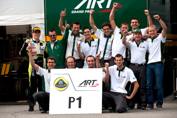 Round 7. Spa-Francorchamps, Spa Belgium. 28th August 2011. Sunday Race. The ART team celebrate victory in the teams classification with Richie Stanaway, (NZL, Lotus ART) and Valtteri Bottas, (FIN, Lotus ART).Portrait.  Photo: Drew Gibson/GP3 Media Service.  ref: Digital Image _Y2Z2245