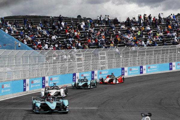 Mitch Evans (NZL), Jaguar Racing, Jaguar I-TYPE 5, leads Andre Lotterer (DEU), Tag Heuer Porsche, Porsche 99X Electric, and Sam Bird (GBR), Jaguar Racing, Jaguar I-TYPE 5