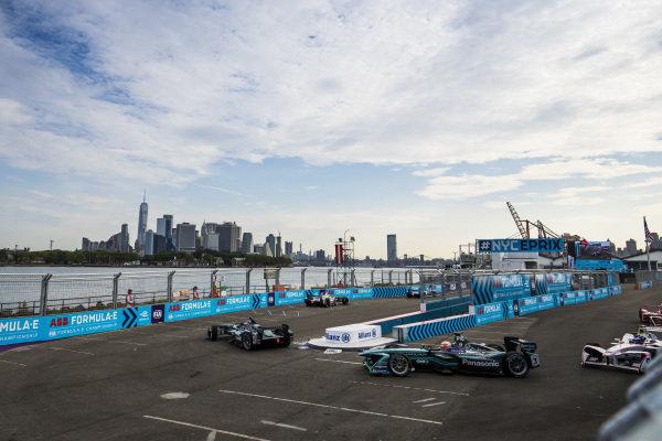 Mitch Evans (NZL), Panasonic Jaguar Racing, Jaguar I-Type II, leads Nelson Piquet Jr. (BRA), Panasonic Jaguar Racing, Jaguar I-Type II.